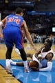 Apr 16, 2014; Oklahoma City, OK, USA;  Oklahoma City Thunder guard Reggie Jackson (15) falls to the floor while driving to the basket against Detroit Pistons guard Peyton Siva (34) during the third quarter at Chesapeake Energy Arena. Mandatory Credit: Mark D. Smith-USA TODAY Sports