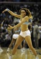 Apr 16, 2014; Memphis, TN, USA; Memphis Grizzlies cheerleader performs during the game against the Dallas Mavericks at FedExForum. Memphis Grizzlies beat the Dallas Mavericks in overtime 106 - 105. Mandatory Credit: Justin Ford-USA TODAY Sports