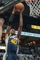 Apr 16, 2014; Minneapolis, MN, USA; Utah Jazz forward Jeremy Evans (40) dunks in the third quarter against the Minnesota Timberwolves at Target Center. The Utah Jazz win 136-130 in double overtime. Mandatory Credit: Brad Rempel-USA TODAY Sports
