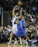 Apr 16, 2014; Memphis, TN, USA; Memphis Grizzlies center Marc Gasol (33) passes the ball over Dallas Mavericks guard Vince Carter (25) during the game at FedExForum. Memphis Grizzlies beat the Dallas Mavericks in overtime 106 - 105. Mandatory Credit: Justin Ford-USA TODAY Sports