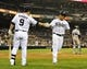 Apr 16, 2014; San Diego, CA, USA; San Diego Padres shortstop Everth Cabrera (2) is congratulated by second baseman Jedd Gyorko (9) after scoring during the fifth inning against the Colorado Rockies at Petco Park. Mandatory Credit: Christopher Hanewinckel-USA TODAY Sports