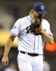 Apr 16, 2014; San Diego, CA, USA; San Diego Padres starting pitcher Andrew Cashner (34) yells into his glove after the final sixth inning against the Colorado Rockies at Petco Park. Mandatory Credit: Christopher Hanewinckel-USA TODAY Sports