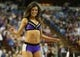Apr 16, 2014; Sacramento, CA, USA; Sacramento Kings dancer performs during a timeout against the Phoenix Suns during the fourth quarter at Sleep Train Arena. The Phoenix Suns defeated the Sacramento Kings 104-99. Mandatory Credit: Kelley L Cox-USA TODAY Sports