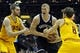 Apr 12, 2014; Cleveland, OH, USA; Brooklyn Nets forward Mason Plumlee (center) drives between Cleveland Cavaliers center Tyler Zeller (left) and guard Matthew Dellavedova (8) in the first quarter at Quicken Loans Arena. Mandatory Credit: David Richard-USA TODAY Sports