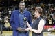 Apr 12, 2014; Cleveland, OH, USA; Cleveland Cavaliers forward Luol Deng (left) is presented the J. Walter Kennedy Citizenship Award by sports writer Mary Schmitt Boyer prior to a game against the Brooklyn Nets at Quicken Loans Arena. The award is named after the second commissioner of the NBA and is presented annually by the Professional Basketball Writers Association to the player, coach or trainer who shows outstanding service and dedication to the community. Mandatory Credit: David Richard-USA TODAY Sports