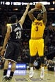 Apr 12, 2014; Cleveland, OH, USA; Cleveland Cavaliers guard Dion Waiters (3) shoots against Brooklyn Nets guard Jorge Gutierrez (13) in the third quarter at Quicken Loans Arena. Mandatory Credit: David Richard-USA TODAY Sports