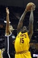 Apr 12, 2014; Cleveland, OH, USA; Cleveland Cavaliers forward Anthony Bennett (15) shoots against Brooklyn Nets guard Jorge Gutierrez (13) in the third quarter at Quicken Loans Arena. Mandatory Credit: David Richard-USA TODAY Sports