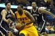 Apr 12, 2014; Cleveland, OH, USA; Cleveland Cavaliers guard Dion Waiters (3) drives between Brooklyn Nets guard Jorge Gutierrez (13) and center Andray Blatche (0) in the third quarter at Quicken Loans Arena. Mandatory Credit: David Richard-USA TODAY Sports
