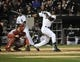 Apr 17, 2014; Chicago, IL, USA; Chicago White Sox left fielder Alejandro De Aza (30) hits a double against the Boston Red Sox during the seventh inning at U.S Cellular Field. Mandatory Credit: David Banks-USA TODAY Sports