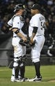 Apr 17, 2014; Chicago, IL, USA;  Chicago White Sox catcher Tyler Flowers (21) talks with relief pitcher Ronald Belisario (54) during the ninth inning of a game against the Chicago White Sox at U.S Cellular Field. Mandatory Credit: David Banks-USA TODAY Sports