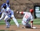 Apr 18, 2014; Chicago, IL, USA;  Cincinnati Reds catcher Devin Mesoraco (39) steals second base as Chicago Cubs second baseman Emilio Bonifacio (64) takes the throw during the fifth inning at Wrigley Field. Mandatory Credit: David Banks-USA TODAY Sports