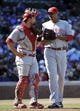 Apr 18, 2014; Chicago, IL, USA; Cincinnati Reds catcher Devin Mesoraco (39) talks with starting pitcher Alfredo Simon (31) during the seventh inning at Wrigley Field. Mandatory Credit: David Banks-USA TODAY Sports