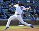 Apr 18, 2014; Chicago, IL, USA; Chicago Cubs relief pitcher James Russell (40) pitches against the Cincinnati Reds during the ninth inning at Wrigley Field. Mandatory Credit: David Banks-USA TODAY Sports