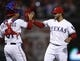 Apr 18, 2014; Arlington, TX, USA; Texas Rangers starting pitcher Martin Perez (33) celebrates with catcher Robinson Chirinos (61) after defeating the Chicago White Sox 12-0 at Rangers Ballpark in Arlington. Mandatory Credit: Jim Cowsert-USA TODAY Sports