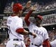 Apr 18, 2014; Arlington, TX, USA; Texas Rangers designated hitter Alex Rios (51) celebrates with manager Ron Washington (38) after scoring a run against the Chicago White Sox during the seventh inning at Rangers Ballpark in Arlington. The Rangers won 12-0. Mandatory Credit: Jim Cowsert-USA TODAY Sports