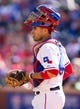 Apr 13, 2014; Arlington, TX, USA; Texas Rangers catcher Robinson Chirinos (61) during the game against the Houston Astros at Globe Life Park in Arlington. The Rangers defeated the Astros 1-0. Mandatory Credit: Jerome Miron-USA TODAY Sports