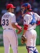 Apr 13, 2014; Arlington, TX, USA; Texas Rangers starting pitcher Martin Perez (33) and catcher Robinson Chirinos (61) during the game at Globe Life Park in Arlington. The Rangers defeated the Astros 1-0. Mandatory Credit: Jerome Miron-USA TODAY Sports