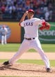 Apr 13, 2014; Arlington, TX, USA; Texas Rangers starting pitcher Alexi Ogando (41) during the game against the Houston Astros at Globe Life Park in Arlington. The Rangers defeated the Astros 1-0. Mandatory Credit: Jerome Miron-USA TODAY Sports