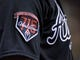 Apr 14, 2014; Philadelphia, PA, USA; Atlanta Braves wearing a commemorative patch honoring Hank Aaron's 715th home run at Citizens Bank Park. The Braves defeated the Phillies, 9-6. Mandatory Credit: Eric Hartline-USA TODAY Sports