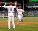 Apr 14, 2014; Philadelphia, PA, USA; Philadelphia Phillies shortstop Jimmy Rollins (11) celebrates after scoring a run with left fielder Domonic Brown (9) against the Atlanta Braves at Citizens Bank Park. The Braves defeated the Phillies, 9-6. Mandatory Credit: Eric Hartline-USA TODAY Sports