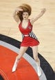 Apr 11, 2014; Toronto, Ontario, CAN; A member of the Toronto Raptors dance pack performs before the start of the game against the New York Knicks at Air Canada Centre. The Knicks beat the Raptors 108-100. Mandatory Credit: Tom Szczerbowski-USA TODAY Sports
