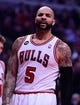 Apr 14, 2014; Chicago, IL, USA; Chicago Bulls forward Carlos Boozer (5) during the first quarter at the United Center. Mandatory Credit: Mike DiNovo-USA TODAY Sports