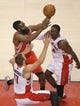Apr 2, 2014; Toronto, Ontario, CAN; Houston Rockets guard James Harden (13) goes to the basket and scores past Toronto Raptors center Jonas Valanciunas (17) and forward Patrick Patterson (54) at Air Canada Centre. The Raptors beat the Rockets 107-103. Mandatory Credit: Tom Szczerbowski-USA TODAY Sports