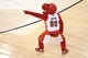 Apr 2, 2014; Toronto, Ontario, CAN; The Toronto Raptors mascot Raptor performs during a break in the action against the Houston Rockets at Air Canada Centre. The Raptors beat the Rockets 107-103. Mandatory Credit: Tom Szczerbowski-USA TODAY Sports