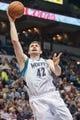 Apr 16, 2014; Minneapolis, MN, USA; Minnesota Timberwolves forward Kevin Love (42) shoots at Target Center. Mandatory Credit: Brad Rempel-USA TODAY Sports