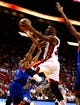 Apr 16, 2014; Miami, FL, USA; Miami Heat guard Norris Cole (30) drives to the basket past Philadelphia 76ers guard Casper Ware (17) in the second half at American Airlines Arena. The 76ers won 100-87. Mandatory Credit: Robert Mayer-USA TODAY Sports