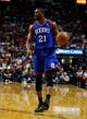 Apr 16, 2014; Miami, FL, USA;  Philadelphia 76ers forward Thaddeus Young (21) dribbles the ball in the first half of a game against the Miami Heat at American Airlines Arena. Mandatory Credit: Robert Mayer-USA TODAY Sports