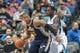Apr 16, 2014; Minneapolis, MN, USA; Utah Jazz center Derrick Favors (15) dribbles against the Minnesota Timberwolves center Gorgui Dieng (5) at Target Center. Mandatory Credit: Brad Rempel-USA TODAY Sports