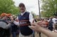 Apr 19, 2014; Auburn, AL, USA;  Auburn Tigers head coach Gus Malzahn leads the team through Tiger Walk prior to the start of the A-Day spring game at Jordan Hare Stadium. Mandatory Credit: John Reed-USA TODAY Sports