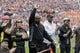 Apr 19, 2014; Auburn, AL, USA;  Auburn former running back Bo Jackson waves after being recognized for his Bo Bikes Bama ride during the first half of the A-Day spring game at Jordan Hare Stadium.  To the left of Jackson is Picabo Street and to the right is Ken Griffey, Jr. Mandatory Credit: John Reed-USA TODAY Sports