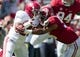Apr 19, 2014; Tuscaloosa, AL, USA;  Alabama Crimson Tide running back Tyren Jones (20) is hit by Alabama linebacker Tim Williams (56)  during the A-Day game at Bryant-Denny Stadium. Mandatory Credit: Marvin Gentry-USA TODAY Sports
