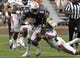 Apr 19, 2014; Auburn, AL, USA; Auburn Tigers receiver D'haquille Williams (1) is tackled by defensive back Brandon King (29) during the first half of the A-Day spring game at Jordan Hare Stadium. Mandatory Credit: John Reed-USA TODAY Sports