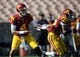 Apr 19, 2014; Los Angeles, CA, USA; Southern California quarterback Max Browne (4) passes the ball off to Southern California tailback James Toland (26) during the Southern California Spring Game at Los Angeles Memorial Coliseum. Mandatory Credit: Kelvin Kuo-USA TODAY Sports