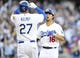 April 19, 2014; Los Angeles, CA, USA; Los Angeles Dodgers center fielder Andre Ethier (16) is greeted at home by center fielder Matt Kemp (27) after hitting a three run home run in the fourth inning against the Arizona Diamondbacks at Dodger Stadium. Mandatory Credit: Gary Vasquez-USA TODAY Sports