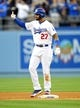April 19, 2014; Los Angeles, CA, USA; Los Angeles Dodgers center fielder Matt Kemp (27) reacts after reaching second on a two run RBI double in the fifth inning against the Arizona Diamondbacks at Dodger Stadium. Mandatory Credit: Gary Vasquez-USA TODAY Sports