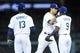 April 19, 2014; Los Angeles, CA, USA; Los Angeles Dodgers center fielder Andre Ethier (16) celebrates the 8-6 victory with shortstop Hanley Ramirez (13) and second baseman Dee Gordon (9) against the Arizona Diamondbacks at Dodger Stadium. Mandatory Credit: Gary Vasquez-USA TODAY Sports