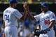 Apr 20, 2014; Los Angeles, CA, USA; Los Angeles Dodgers relief pitcher Kenley Jansen (74) celebrates with right fielder Yasiel Puig (66) after defeating the Arizona Diamondbacks 4-1 at Dodger Stadium. Mandatory Credit: Robert Hanashiro-USA TODAY Sports
