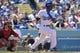 Apr 20, 2014; Los Angeles, CA, USA; Los Angeles Dodgers second baseman Dee Gordon (9) singles in the sixth inning against Arizona Diamondbacks at Dodger Stadium. Mandatory Credit: Robert Hanashiro-USA TODAY Sports