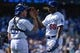 Apr 20, 2014; Los Angeles, CA, USA: Los Angeles Dodgers catcher Tim Federowicz (26) celebrates with right fielder Yasiel Puig (66) after defeating the Arizona Diamondbacks 4-1 at Dodger Stadium. Mandatory Credit: Robert Hanashiro-USA TODAY Sports