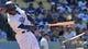 Apr 20, 2014; Los Angeles, CA, USA: Los Angeles Dodgers shortstop Hanley Ramirez (13) breaks a bat during the eighth inning against the Arizona Diamondbacks  at Dodger Stadium. The Dodgers won 4-1. Mandatory Credit: Robert Hanashiro-USA TODAY Sports