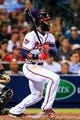 Apr 21, 2014; Atlanta, GA, USA; Atlanta Braves right fielder Jason Heyward (22) hits an RBI single in the seventh inning against the Miami Marlins at Turner Field. Mandatory Credit: Daniel Shirey-USA TODAY Sports