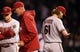 Apr 21, 2014; Chicago, IL, USA; Arizona Diamondbacks starting pitcher Bronson Arroyo (61) walks to the dugout after being relieved by manager Kirk Gibson (middle) during the sixth inning against the Chicago Cubs at Wrigley Field. Mandatory Credit: Jerry Lai-USA TODAY Sports
