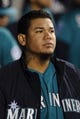 Apr 21, 2014; Seattle, WA, USA; Seattle Mariners starting pitcher Felix Hernandez (34) in the dugout during the fifth inning against the Houston Astros at Safeco Field. Mandatory Credit: Steven Bisig-USA TODAY Sports