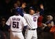 Apr 22, 2014; Chicago, IL, USA; Chicago Cubs players John Baker (right) and Ryan Kalish (51) celebrate after both scoring against the Arizona Diamondbacks during the eighth inning at Wrigley Field. Mandatory Credit: Jerry Lai-USA TODAY Sports