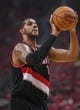 Apr 20, 2014; Houston, TX, USA; Portland Trail Blazers forward LaMarcus Aldridge (12) attempts a free throw during the first quarter against the Houston Rockets in game one during the first round of the 2014 NBA Playoffs at Toyota Center. Mandatory Credit: Troy Taormina-USA TODAY Sports