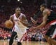 Apr 20, 2014; Houston, TX, USA; Houston Rockets forward Terrence Jones (6) drives the ball during the third quarter as Portland Trail Blazers forward LaMarcus Aldridge (12) defends in game one during the first round of the 2014 NBA Playoffs at Toyota Center. Mandatory Credit: Troy Taormina-USA TODAY Sports
